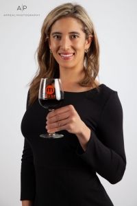 Studio photograph of model enjoying wine